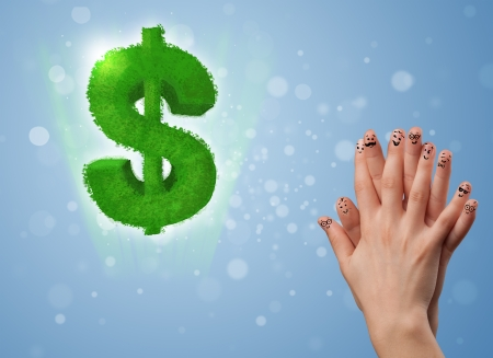 Happy cheerful smiley fingers looking at green leaf dollar sign Stock Photo - 22332480