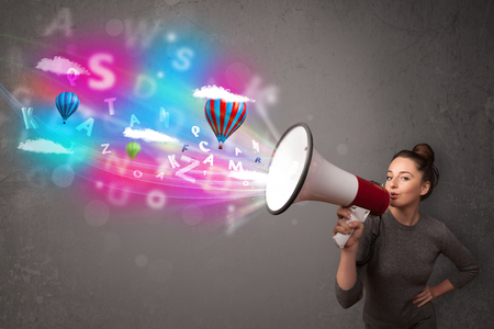 Cute girl shouting into megaphone and abstract text and balloons come out Stock Photo - 22521274