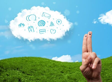 Happy cheerful smiley fingers looking at cloud with blue social icons and smybols Stock Photo - 22332301