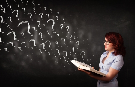 Confused woman reading a book with question marks coming out from it Stock Photo - 22521340