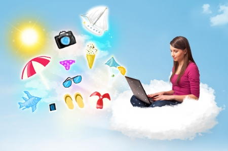 Pretty young woman sitting in cloud with laptop, summer travel concept photo
