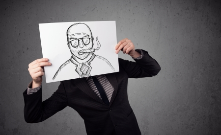 hiding face: Businessman holding a cardboard with a smoking man on it in front of his head