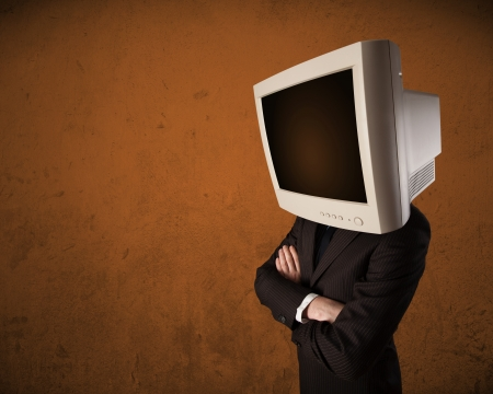 Business man with a monitor on his head concept and brown empty space photo