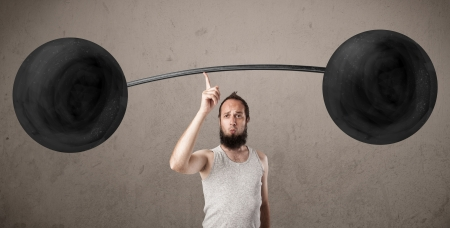 twiggy: Funny skinny guy lifting incredible weights Stock Photo