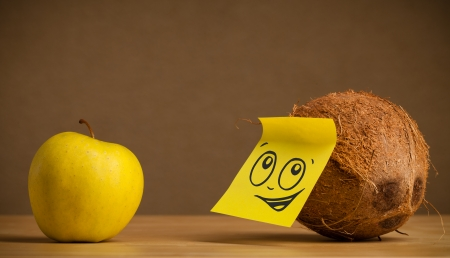 reacting: Coconut with sticky post-it note reacting to apple