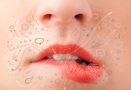 Pretty woman mouth blowing hand drawn icons and symbols close up Stock Photo - 22649492