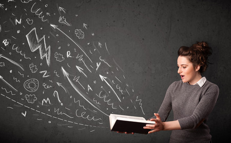 Young woman reading a book while hand drawn sketches coming out of the book Stock Photo - 22649504