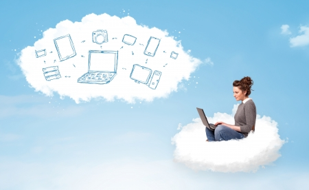 woman sitting with laptop: Pretty young woman sitting in cloud with laptop, cloud computing concept