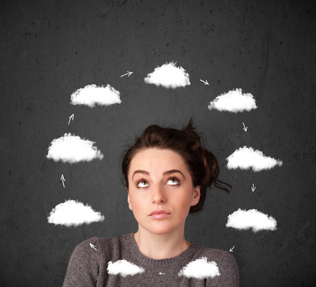 Thoughtful young woman with drawn clouds circulating around her head photo