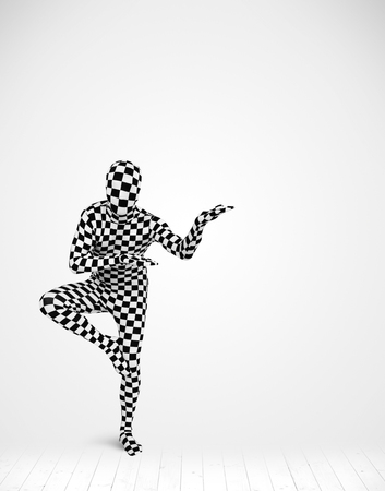 anonymity: man in full body suit presenting your product over white background Stock Photo