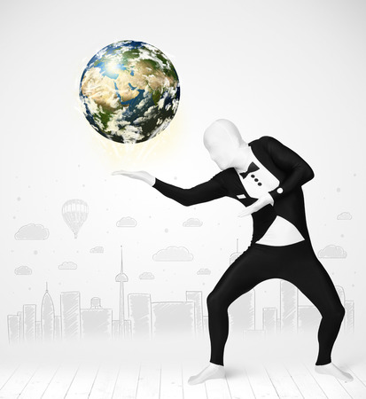 sphere standing: Funny man in full body suit holding planet earth, Elements of this image furnished by NASA Stock Photo