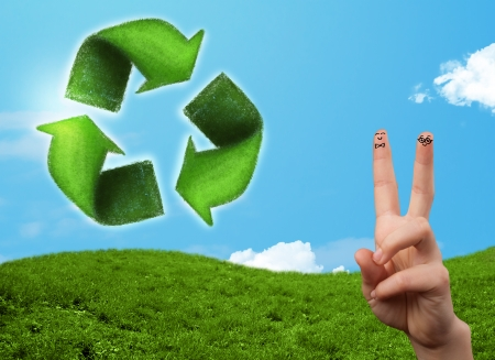 Happy cheerful smiley fingers looking at green leaf recycle sign photo