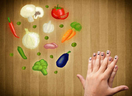 Happy smiley face fingers cheerfully looking at illustration of colorful healthy vegetables illustration