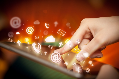 Finger pointing on tablet pc, social media concept photo