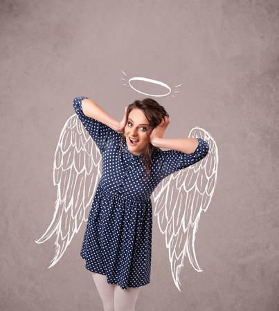 Cute girl with angel illustrated wings on grungy background photo