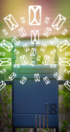 Mailbox with letter icons exploding on glowing green background photo