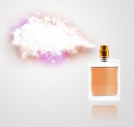 women's perfume in beautiful bottle spraying colorful cloud, copyspace in cloud photo