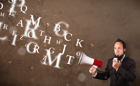 Man in shirt shouting into megaphone and abstract text come out Stock Photo - 22997799