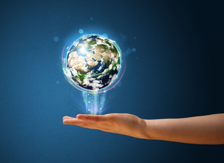 Young woman holding in her hand a glowing earth globe, Elements of this image furnished by NASA photo