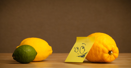 reacting: Lemon with sticky post-it note reacting at citrus fruits