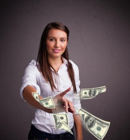 Beautiful young girl throwing money photo