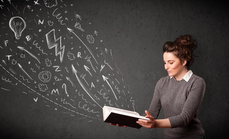 Young woman reading a book while hand drawn sketches coming out of the book Stock Photo - 22961108