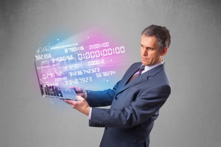 Attractive businessman holding notebook with exploding data and numbers photo