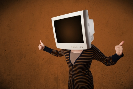 Girl with a computer monitor on her head and empty brown copyspace photo