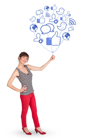 Happy young lady holding social icon balloon photo