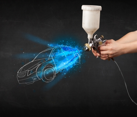 airgun: Worker with airbrush gun painting hand drawn white car lines Stock Photo