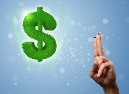 Happy cheerful smiley fingers looking at green leaf dollar sign Stock Photo - 22963514