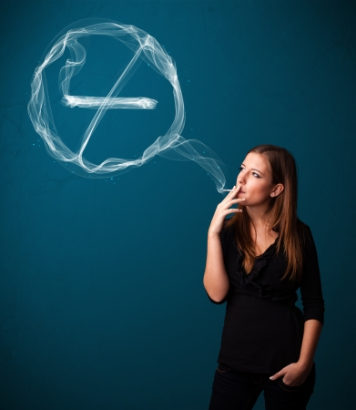 Pretty young lady smoking unheathy cigarette with no smoking sign photo