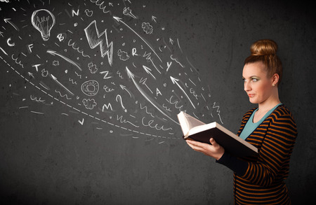 Young woman reading a book while hand drawn sketches coming out of the book Stock Photo - 23200428