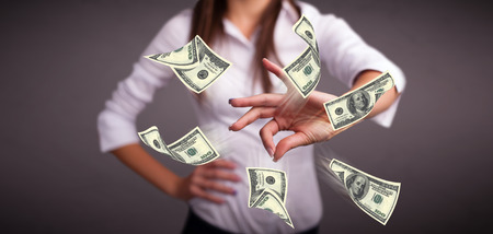 Beautiful young girl throwing money Stock Photo - 23159615