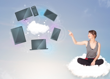 Pretty young girl sitting on cloud enjoying cloud network service photo
