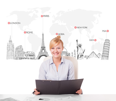 symbol tourism: Beautiful young businesswoman with world map and major landmarks of the world Stock Photo