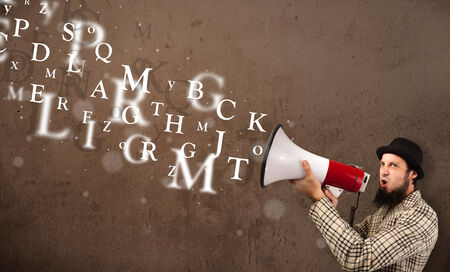 Man in shirt shouting into megaphone and abstract text come out Stock Photo - 23203763