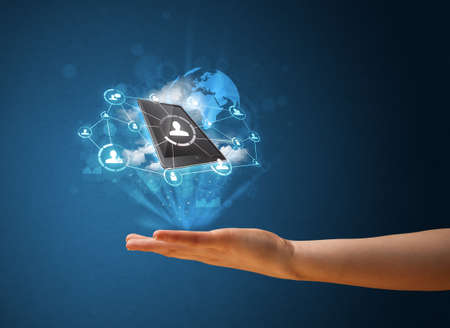Young businesswoman presenting cloud technology in her hand photo