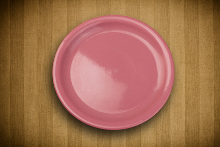 Colorful empty shiny plate on grungy background table  Stock Photo - 23158397