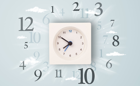 Modern clock with numbers on the side and clouds photo