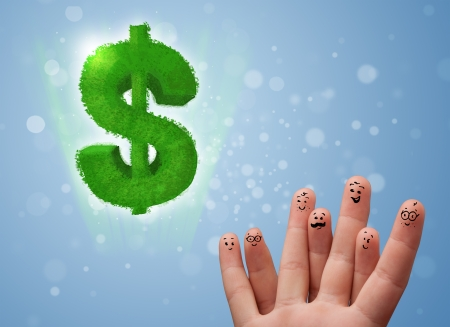 Happy cheerful smiley fingers looking at green leaf dollar sign Stock Photo - 23336153