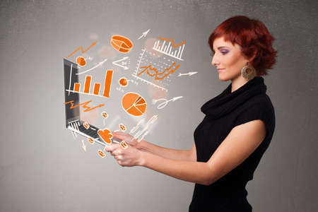 woman holding money: Beautiful young lady holding laptop with graphs and statistics Stock Photo