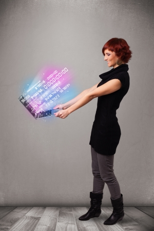 numers: Attractive casual woman holding laptop with exploding data and numers