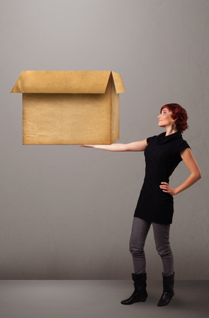 Beautiful young woman holding an empty cardboard box Stock Photo