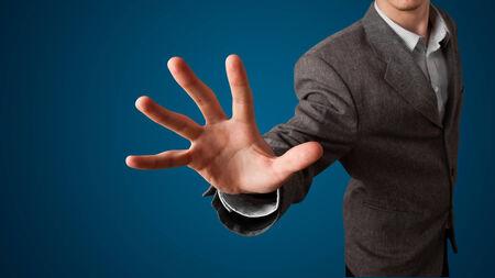 Young businessman pressing imaginary button photo