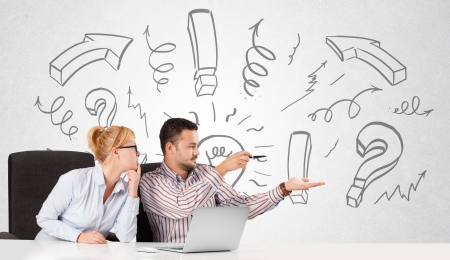 Young businessman and businesswoman brainstorming with drawn arrows and symbols photo
