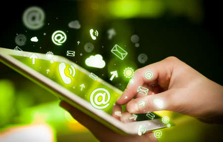 media gadget: Finger pointing on tablet pc, social media concept