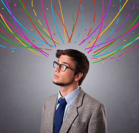 icom: Young man standing and thinking wiht colorful abstract lines overhead