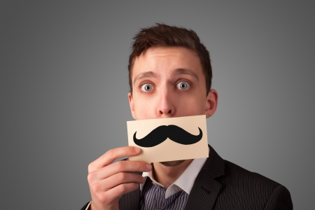 Happy businessman holding funny mustache card on his mouth with gradient background Stock Photo