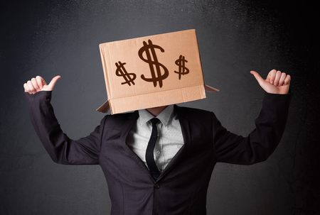 masquerader: Young man standing and gesturing with a cardboard box on his head with dollar signs Stock Photo
